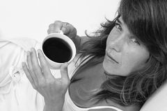 Coffee break. Woman looking up with coffee in her hands Stock Photos