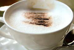 Coffee Break in the afternoon. Cup of coffee with soft focus on chocolate powder Royalty Free Stock Image