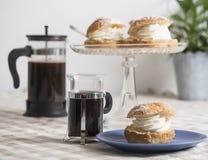 Coffee break with almond bun Royalty Free Stock Photo