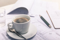 Coffee break at the architect desktop Stock Image