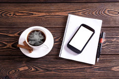 Coffee break background.Office table top view. Coffee break background.On the office desk coffee, notepad, pen and smart phone Stock Images
