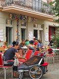 Coffee break in Berlin. Young families enjoying coffee at an outdoor cafe in Prenzlauer Berg, Berlin Stock Photos