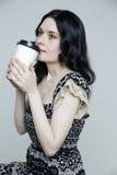 Coffee break with big white cup. Pretty woman. Coffee break with big white cup. isolated on gray background studio portrait Stock Photography