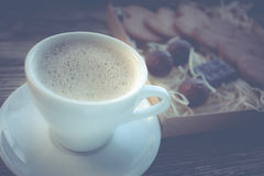 Coffee break, breakfast. Cup of coffee with biscuit cookies Royalty Free Stock Photo