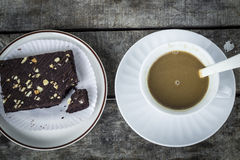 Coffee break with brownies. Drink at the dawn of middle age. Strengthen energy, but fat royalty free stock image