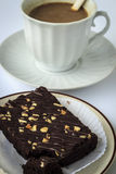 Coffee break with brownies. Drink at the dawn of middle age. Strengthen energy, but fat stock photos