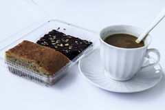 Coffee break with brownies. Drink at the dawn of middle age. Strengthen energy, but fat stock photography