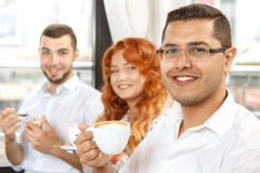 Coffee break of busines colleagues. Business colleagues on coffee break in cafe Royalty Free Stock Photo