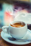 Coffee break business. Cup of coffee mobile phone and newspaper Stock Images