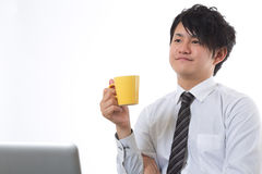 Coffee break of the businessman. The businessman who takes a break Royalty Free Stock Photos