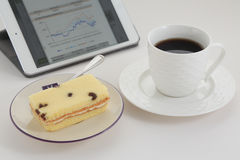 Coffee break. With cake and tablet Royalty Free Stock Photo