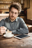 Coffee break with cappuccino Stock Images