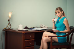 Coffee break charming businesswoman in the office Stock Photography