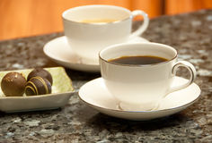 Coffee break with chocolates Stock Images