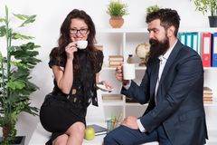 Coffee break with colleague. Man and woman pleasant conversation during coffee break. Discussing office rumors. Ask for. Coffee break with colleague. Man and royalty free stock images