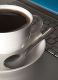 Coffee break from computer. Modern cup and laptop royalty free stock images
