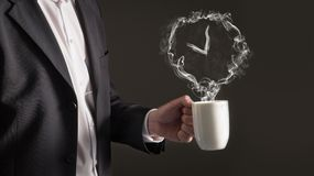 Coffee break concept. Clock sign from steam. Royalty Free Stock Photos
