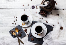 Coffee break concept. Cups and beans, breakfast theme. Breakfast, food, still life, coffee break concept. Cup with black coffee and beans on a rustic white stock photography