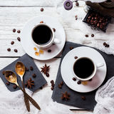 Coffee break concept. Cups and beans, breakfast theme. Breakfast, food, still life, coffee break concept. Cup with black coffee and beans on a rustic white royalty free stock image