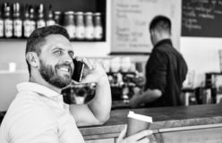Coffee break concept. Glad to hear you. Coffee take away option for busy people. Man mobile conversation cafe barista. Background. Drink coffee while waiting stock photos