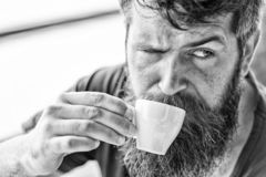 Coffee break concept. Guy relaxing with espresso coffee. Enjoy hot drink. Hipster drinking coffee outdoor. Man with stock image