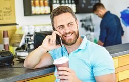 Coffee break concept. Coffee take away option for busy people. Man mobile conversation cafe barista background. Drink. Coffee while waiting. Waiting for you stock photos