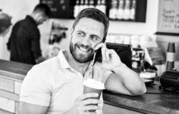 Coffee break concept. Coffee take away option for busy people. Man mobile conversation cafe barista background. Drink. Coffee while waiting. Waiting for you royalty free stock images
