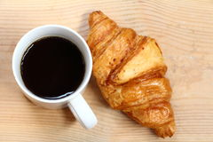Coffee break and croissant Stock Photos