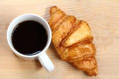Coffee break and croissant Stock Photos