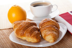 Coffee break with croissant Stock Photos