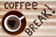 Coffee Break with cup of coffee. Coffee Break text with coffee beans on wooden board as background Royalty Free Stock Image
