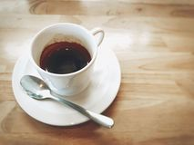 Coffee break. A cup of coffee place on a wooden Royalty Free Stock Photo