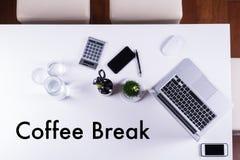 Coffee break on empty meeting table as symbol Stock Photos
