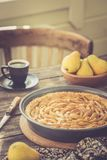 Coffee break with french pear tart, vintage toned Royalty Free Stock Image