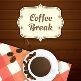 Coffee break illustration with cup of coffee and coffee beans, red checkered tablecloth on wooden table. Stock Photo