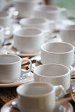 Coffee break. Many empty porcelain cups arranged for a coffee break stock photos