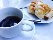 Coffee break. Morning coffee break and a piece of croissant Stock Photography