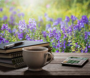 Coffee break with notebooks and pen on wooden table in the garde Royalty Free Stock Photos