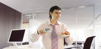 Coffee break in the office. Businessman in the office wants coffee break royalty free stock photos