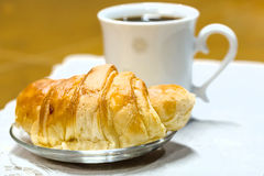 The coffee break with office. A croissant with coffee cup Stock Photo