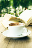 Coffee break and open book on wooden table Stock Photo