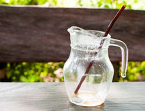 The Coffee break is over. Empty glass of coffee with brown straw Stock Photography