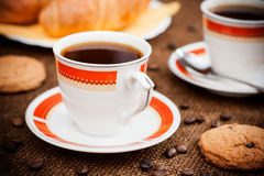 Coffee break. Photo with the image of a cup of coffee and confectionery products royalty free stock photography