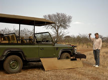 Coffee break on Safari. Man holding up coffee cup during a coffee break on safari in Africa Royalty Free Stock Photos