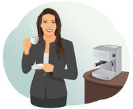 Coffee break. Smiling businesswoman is having a coffee break in the office. Coffee machine Royalty Free Stock Photo