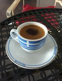 Greek Coffee In A Demitasse Cup With The Flag Of Greece royalty free stock image