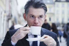 Coffee Break. Sucessful  businessman enjoying in a cup of coffee Stock Images