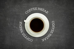 Coffee break text on blackboard with coffee cup Royalty Free Stock Photography