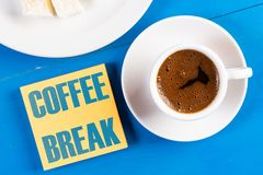 Coffee Break Text Concept With Cup Of Coffee On The Table royalty free stock photo