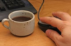 Coffee break to the computer Stock Image